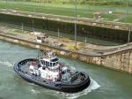 A tug makes its way through the locks.